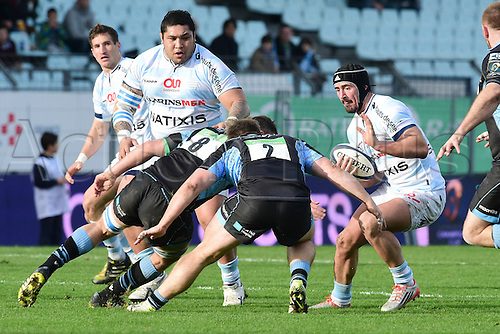09.01.2016. Paris, France. European Champions Cup Rugby Union. Racing Metro versus Glasgow Warriors.  Alexandre Dumoulin (RM92) is tackled by Pat MacArthur and Adam Ashe (Gasgow)