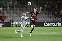 1st January 2020; Bankwest Stadium, Parramatta, New South Wales, Australia; Australian A League football, Western Sydney Wanderers versus Brisbane Roar; Roy O'Donovan of Brisbane Roar and Patrick Ziegler of Western Sydney Wanderers challenge for the high ball - Editorial Use