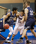 SIOUX FALLS, SD: MARCH 22: Gokul Natesan #31 from Colorado Mines drives as Jarek Coles #21 from Bellarmine works through a screen during the Men's Division II Basketball Championship Tournament on March 22, 2017 at the Sanford Pentagon in Sioux Falls, SD. (Photo by Dick Carlson/Inertia)