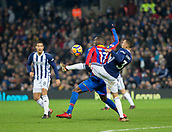 2nd December 2017, The Hawthorns, West Bromwich, England; EPL Premier League football, West Bromwich Albion versus Crystal Palace; Kieran Gibbs of West Bromwich Albion reaches his leg high around Christian Benteke of Crystal Palace  to kick the ball