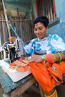 Kuna woman sewing molas on ancient Singer sewing machine, Comarca De Kuna Yala, San Blas Islands, Panama