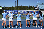 24 April 2016: UNC players watch the final doubles set. The University of North Carolina Tar Heels played the University of Miami Hurricanes at the Cary Tennis Center in Cary, North Carolina in the Atlantic Coast Conference Women's Tennis Tournament Championship. North Carolina won the match 4-2.