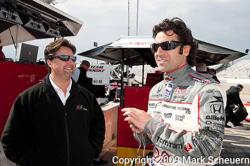 May 30 2009: IndyCar team owner Michael Andretti (left) and driver Dario Franchitti (right) talk before practice for the ABC Supply Company A.J. Foyt 225 at the Milwaukee Mile in West Allis, WI.