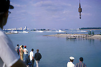 Miss Budweiser crewman Bob Cunningham watches the start of the 7 Litre Div I race at Miami Marine Stadium in 1969. The Miss Budweiser is 2nd from the left and Long Gone is 4th from left.