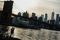 BROOKLYN, NY - APRIL 09: Lower Manhattan, World Trade Center and Brooklyn bridge are seen as people enjoy  a warm day at Brooklyn Bridge park on April 09, 2017 in Brooklyn, New York. . Photo by VIEWpress/Eduardo MunozAlvarez