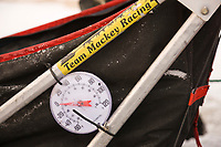 2008 All Alaska Sweepstakes 100 year commemorative sled dog race dog staging area before the start of the race in Nome, Alaska. Lance Mackey's sled and temperature sign.