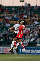 Abby Wambach of the magicJack and Candace Chapman (5) of the Western New York Flash during second half action. The Western New York Flash defeated the magicJack 3-0 in Women's Professional Soccer (WPS) at Sahlen's Stadium in Rochester, NY May 22, 2011.
