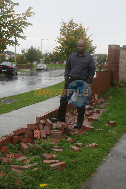 Edman Chitare with his wall that was knocked down by vandals...Photo NEWSFILE/Jenny Matthews.(Photo credit should read Jenny Matthews/NEWSFILE)....This Picture has been sent you under the condtions enclosed by:.Newsfile Ltd..The Studio,.Millmount Abbey,.Drogheda,.Co Meath..Ireland..Tel: +353(0)41-9871240.Fax: +353(0)41-9871260.GSM: +353(0)86-2500958.email: pictures@newsfile.ie.www.newsfile.ie.FTP: 193.120.102.198.