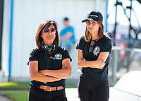 Oct 18, 2019; Ennis, TX, USA; NHRA top alcohol dragster driver Jasmine Salinas (right) talks with mother Monica Salinas during qualifying for the Fall Nationals at the Texas Motorplex. Mandatory Credit: Mark J. Rebilas-USA TODAY Sports