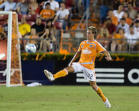 Houston Dynamo  midfielder Stuart Holden (22) gets a touch on the ball. Houston Dynamo defeated Atlante FC 4-0 during the group stage of the Superliga 2008 tournament at Robertson Stadium in Houston, TX on July 12, 2008.
