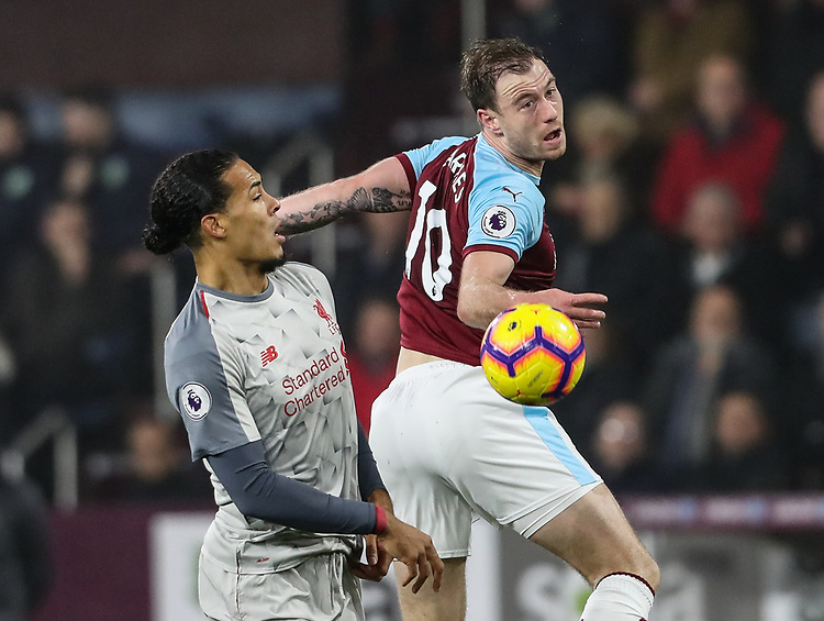 Burnley's Ashley Barnes competing with Liverpool's Virgil van Dijk<br /> <br /> Photographer Andrew Kearns/CameraSport<br /> <br /> The Premier League - Burnley v Liverpool - Wednesday 5th December 2018 - Turf Moor - Burnley<br /> <br /> World Copyright &copy; 2018 CameraSport. All rights reserved. 43 Linden Ave. Countesthorpe. Leicester. England. LE8 5PG - Tel: +44 (0) 116 277 4147 - admin@camerasport.com - www.camerasport.com