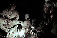 US ARMY soldiers from 2nd platoon, battle company, 2nd battalion, 503d regiment, 173d airborne brigade conduct a search and attack of villages operation in the Afghansitan Zabul province between August 26 and 28 2005..Air assault mission, 2nd platoon searched the villages of Dawlatkel and Kaman covering on foot in 48 hours more than 14 km of desertic territory. They were looking for IEDs (improvvised explosive devices) on the street that connects the two villages and explosive device builders operating in the viillages. Taleban are extensivly present in the area. Afghan National police refused to operate between the two villages due to high risks of engaging  the talebans and passing on possible IEDs.. walking in temperatures that reach 120F carrying gear as heavy as 100 pounds  is very hard on the soldiers making these opearation among the hardest in the war against terror.