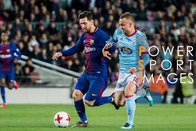Lionel Andres Messi (L) of FC Barcelona fights for the ball with Stanislav Lobotka of RC Celta de Vigo during the Copa Del Rey 2017-18 Round of 16 (2nd leg) match between FC Barcelona and RC Celta de Vigo at Camp Nou on 11 January 2018 in Barcelona, Spain. Photo by Vicens Gimenez / Power Sport Images