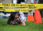 Jazmine Martinez, 5, runs the Carson City Sheriff's SWAT obstacle course during the 16th annual National Night Out event, hosted by the Carson City Sheriff's Office, in Carson City, Nev., on Tuesday, Aug. 7, 2018.<br /> Photo by Cathleen Allison/Nevada Momentum