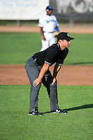Umpire Isaias Barba handles the calls on the bases during the Pioneer League game between the Ogden Raptors and the Grand Junction Rockies at Lindquist Field on July 6, 2015 in Ogden, Utah. Ogden defeated Grand Junction 8-7. (Stephen Smith/Four Seam Images)