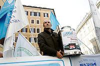 I sindacati di polizia mostrano taniche per appellarsi alla carenza di carburante, durante una protesta contro i tagli alla sicurezza, a Montecitorio, Roma, 18 ottobre 2011..Police unions protest against cuts to security, outside of the Lower Chamber, Rome, 18 october 2011..UPDATE IMAGES PRESS/Riccardo De Luca