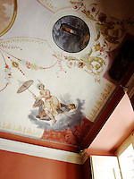 This detail of the study ceiling reveals part of a charming fresco