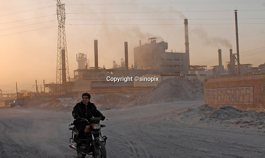 A man rides the motorcycles in a township called Datong near Linfen City in Shanxi, China. Linfen has been identified as one of the most polluted cities in China..30 Jan 2007