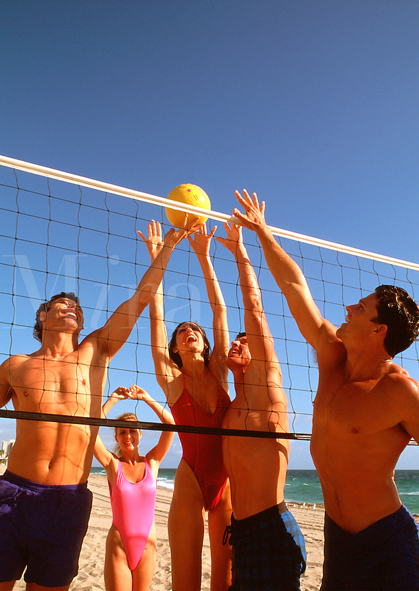 People playing volleyball on the beach