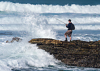 Man Fishing off a Rocky Point on the Coast of  Los Osos