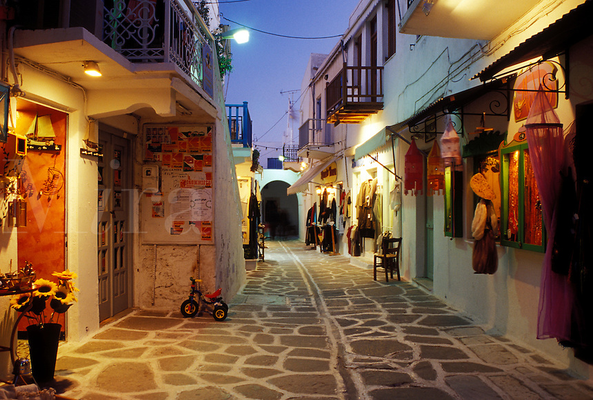 Greece, Paros, Greek Islands, Parikia, Cyclades, Europe, Shops along the narrow pedestrian streets in Plateia Mavrogenous in the evening in the town of Parikia on Paros Island.