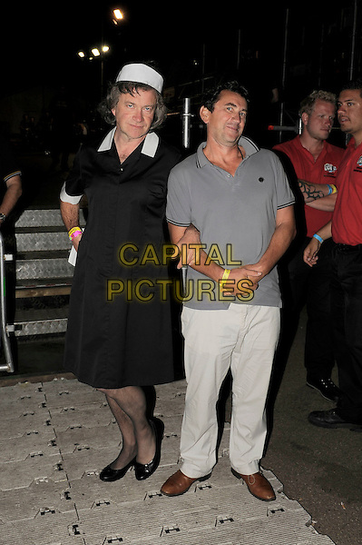 Harry Enfield and Phil Daniels .backstage at BT London Live Closing Ceremony Celebration Concert, Hyde Park London, England. .12th August 2012.full length grey gray top trousers maid costume black white   .CAP/MAR.© Martin Harris/Capital Pictures.