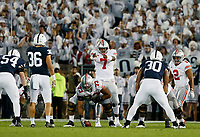 Ohio State Buckeyes quarterback Dwayne Haskins Jr. (7) calls out a play at the line of scrimmage during the first quarter of the NCAA football game against the Penn State Nittany Lions at Beaver Stadium in University Park, Pa. on Sept. 29, 2018. [Adam Cairns / Dispatch]