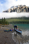 Trent Enzsol loads a Clipper canoe with camping gear.  Maligne Lake, Jasper National Park, Alberta, Canada.