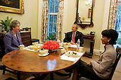 """Washington, D.C. - March 14, 2005 -- United States President George W. Bush meets with Karen Hughes and United States Secretary of State Condoleezza Rice for breakfast in the President's private dining room at the White House in Washington, D.C. on  Monday, March 14, 2005. Secretary Rice announced later in the day that Karen Hughes will be nominated as Under Secretary of State for Public Diplomacy and Public Affairs. In a statement, the President said  """"Our long-term strategy to keep the peace is to help change the conditions that give rise to extremismandterrorby spreadingtheuniversal principle ofhuman liberty. This will require anaggressive effort to share andcommunicateAmerica's fundamental values while respecting the cultures and traditions of other nations.Karen Hughes has beenone of my mosttrusted and closest advisers, and she has the experience, expertise, and judgment to lead this critical effort.Her return to public service in this important position signifies my personal commitment to the international diplomacy that is neededin these historic times. I value her counsel and friendship, as does Secretary Rice.""""<br /> Mandatory Credit: Krisanne Johnson - White House via CNP"""