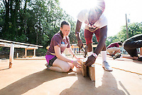 Service DAWGS Day: Freshman MSU student volunteers Kate Armstrong and LaDarius Beason help out at Habitat for Humanity Maroon Edition house.<br />