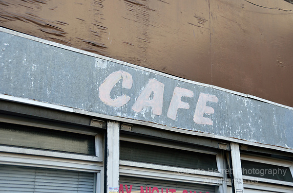 Neglected dilapidated cafe exterior.