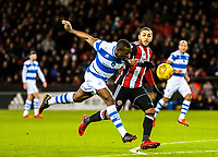Queens Park Rangers defender Nedum Onuoha (5) beats Sheffield United's forward Leon Clarke (9) to the ball during the Sky Bet Championship match between Sheff United and Queens Park Rangers at Bramall Lane, Sheffield, England on 20 February 2018. Photo by Stephen Buckley / PRiME Media Images.