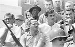 Residents of Philadelphia Ms watch as the 2nd Meredith March Against Fear enters town. Photographed by Jim Peppler for essay published in The Southern Courier on June 25, 1966. Copyright Jim Peppler/1966. This and over 10,000 other images are part of the Jim Peppler Collection at The Alabama Department of Archives and History:  http://digital.archives.alabama.gov/cdm4/peppler.php