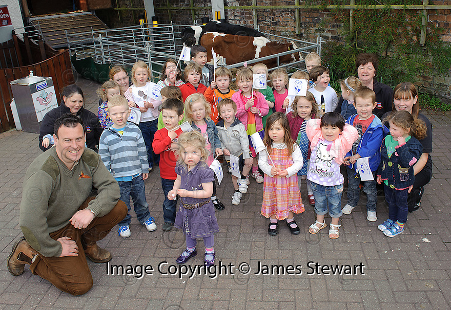 The kids from Wellside Kindergarten, Falkirk with Nathan Anderson-Dickson and his dairy cows.