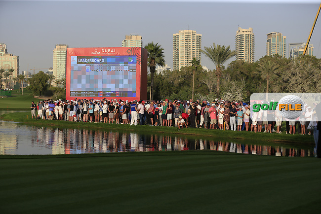 A crowd around the 18th green during Round 4 of the Omega Dubai Desert Classic, Emirates Golf Club, Dubai,  United Arab Emirates. 27/01/2019<br /> Picture: Golffile | Thos Caffrey<br /> <br /> <br /> All photo usage must carry mandatory copyright credit (&copy; Golffile | Thos Caffrey)