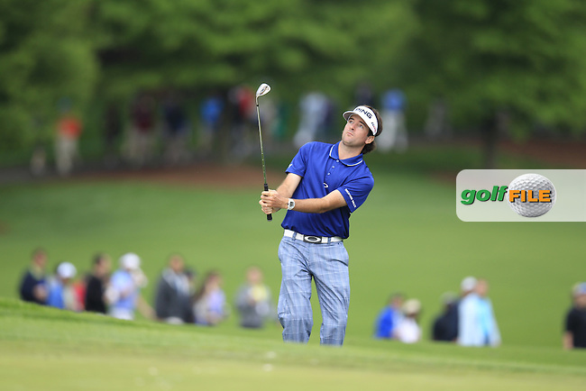 Bubba Watson (USA) chips onto the 15th green during Thursday's Round 1 of the 2013 Wells Fargo Championship at Quail Hollow Club, Charlotte, North Carolina, 2nd May 2013..Picture: Eoin Clarke www.golffile.ie.