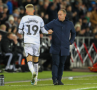 29th November 2019; Liberty Stadium, Swansea, Glamorgan, Wales; English Football League Championship, Swansea City versus Fulham; Steve Cooper manager of Swansea City shakes hands with Sam Surridge of Swansea City as he leaves the field - Strictly Editorial Use Only. No use with unauthorized audio, video, data, fixture lists, club/league logos or 'live' services. Online in-match use limited to 120 images, no video emulation. No use in betting, games or single club/league/player publications