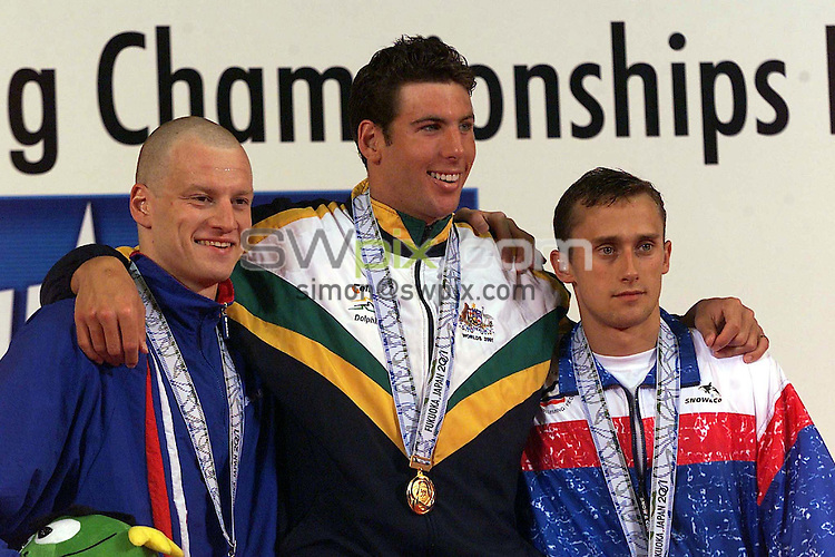 Pix: Patrick.B.Kramer/SWpix.com. Swimming,World Championships Fukuoka, Japan. 26/07/2001...COPYWRIGHT PICTURE>>SIMON WILKINSON>>01943 436649>>..Graeme Smith (Silver), left, Grant Hackett (Gold) and Alexei Filipets (Bronce) at the medal ceremony for the mens 1500m freestyle final at 9th FINA World Championships in Fukuoka on Sunday  July 29, 2001