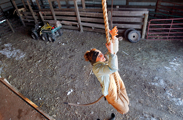 Early morning rope climbing inside a barn on her family's rural Batavia farm is a daily ritual for Megan Black, a sophomore wrestler at Ottumwa High School.  Black is hoping to be the first girl to ever qualify for the state wrestling meet.  She says the hard work she does on the family farm has helped prepare her for tough competition on the wrestling mat.
