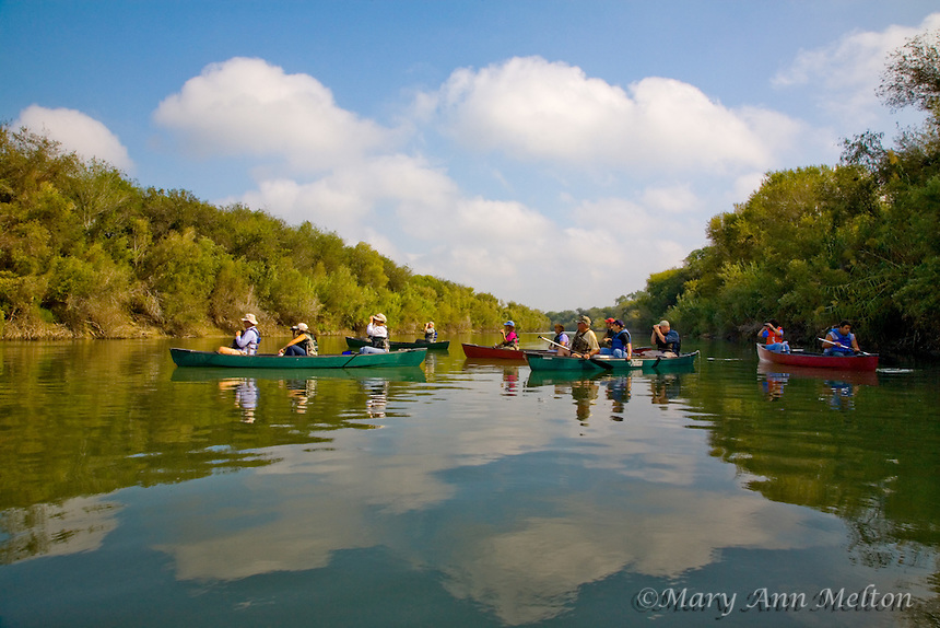 Canoe the Rio Grande - Rio Grande Valley Bird Festival  Participants watch for birds as they paddle down the Rio Grande River .