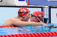 PICTURE BY ALEX BROADWAY /SWPIX.COM - 2012 London Paralympic Games - Day Five - Swimming, Aquatic Centre, Olympic Park, London, England - 03/09/12 - Natalie Jones & Eleanor Simmonds of Great Britain celebrate after winning Bronze and Gold respectively in the Women's 200m Individual Medley SM6 Final.