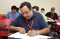 New York, NY, USA - June 24-25, 2017: OrigamiUSA 2017 Convention at St. John's University, Queens, New York, USA. The challenge: Edward Mistretta (right) teaching a class how to fold his complex design, Trombone with Moving Slide. Sachin Shah, Illinois at work.