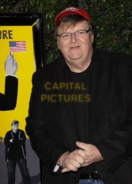 "MICHAEL MOORE .""Capitalism: A Love Story"" Los Angeles Premiere held At AMPAS Samuel Goldwyn Theater, Beverly Hills, California, USA..September 15th, 2009.half length black suit jacket red baseball cap hat glasses hands.CAP/ADM/KB.©Kevan Brooks/AdMedia/Capital Pictures."