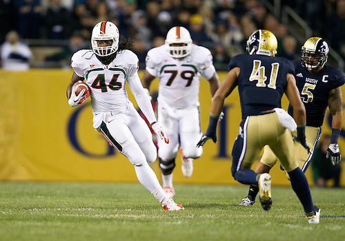 October 06, 2012:  Miami tight end Clive Walford (46) runsf for yardage during NCAA Football game action between the Notre Dame Fighting Irish and the Miami Hurricanes at Soldier Field in Chicago, Illinois.  Notre Dame defeated Miami 41-3.