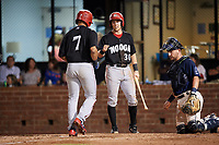 Chattanooga Lookouts catcher Brian Olson (30) greets LaMonte Wade (7) as he crosses home plate in front of catcher Michael Barash (16) during a game against the Mobile BayBears on May 5, 2018 at Hank Aaron Stadium in Mobile, Alabama.  Chattanooga defeated Mobile 11-5.  (Mike Janes/Four Seam Images)