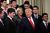United States President Donald J. Trump with US Secretary of Education Betsy DeVos greets athletes from the Stanford University Men's Golf as part of NCAA Collegiate National Champions Day at the White House in Washington on November 22, 2019. <br /> Credit: Yuri Gripas / Pool via CNP