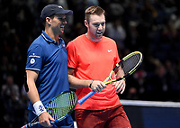Jack Sock and Mike Bryan all smiles after winning against Pierre-Hughes Herbert and Nicolas Mahut in their doubles Final match today<br /> <br /> Photographer Hannah Fountain/CameraSport<br /> <br /> International Tennis - Nitto ATP World Tour Finals Day 8 - O2 Arena - London - Sunday 18th November 2018<br /> <br /> World Copyright &copy; 2018 CameraSport. All rights reserved. 43 Linden Ave. Countesthorpe. Leicester. England. LE8 5PG - Tel: +44 (0) 116 277 4147 - admin@camerasport.com - www.camerasport.com