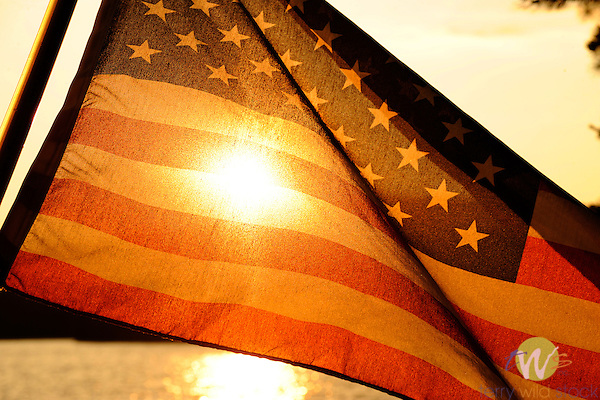 American Flag with Moosehead Lake sunset.
