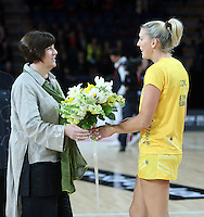 20.09.2012 Australian Catherine Cox recieves flowers for her 100th test during the second netball test match between the Silver Ferns and the Australian Diamonds played at Vector Arena in Auckland. Mandatory Photo Credit ©Michael Bradley.