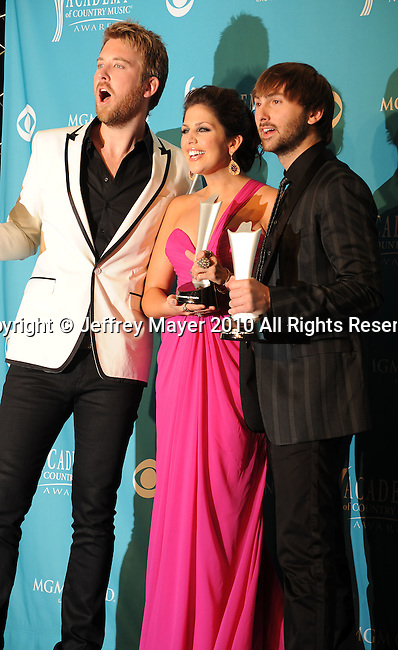 LAS VEGAS, NV. - April 18: Musician Charles Kelley, singers Hilary Scott, and Dave Haywood of the band Lady Antebellum, winner of Song of the Year pose in the press room during the 45th Annual Academy of Country Music Awards at the MGM Grand Garden Arena on April 18, 2010 in Las Vegas, Nevada.